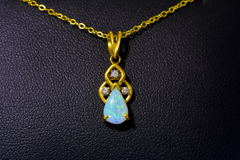 Lady's White Gold Opal and Diamond Pendant