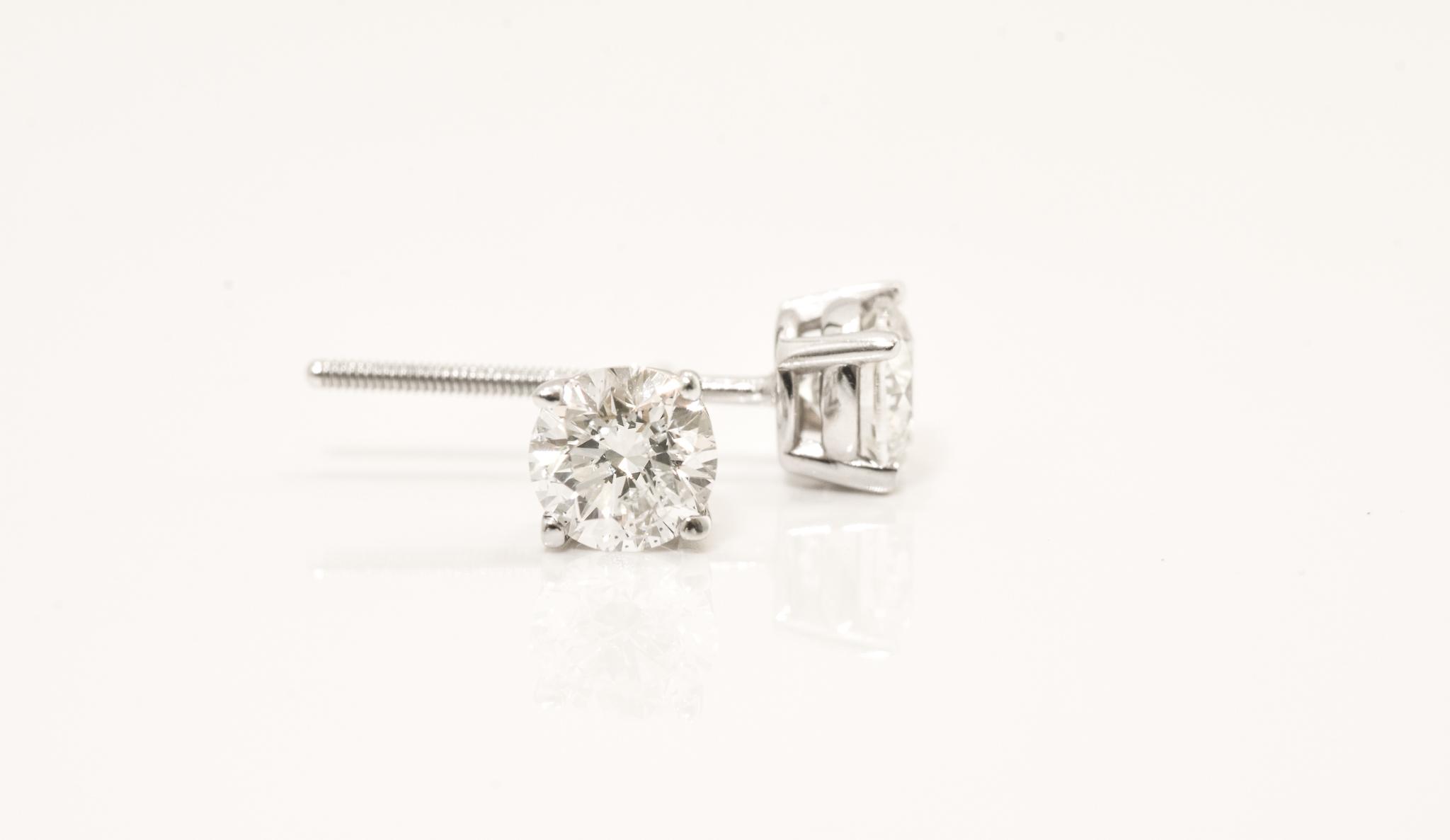 Diamond Stud Earrings. .75 Carat tdwt.,  Set in White Gold.  SI2-I1, G-H.