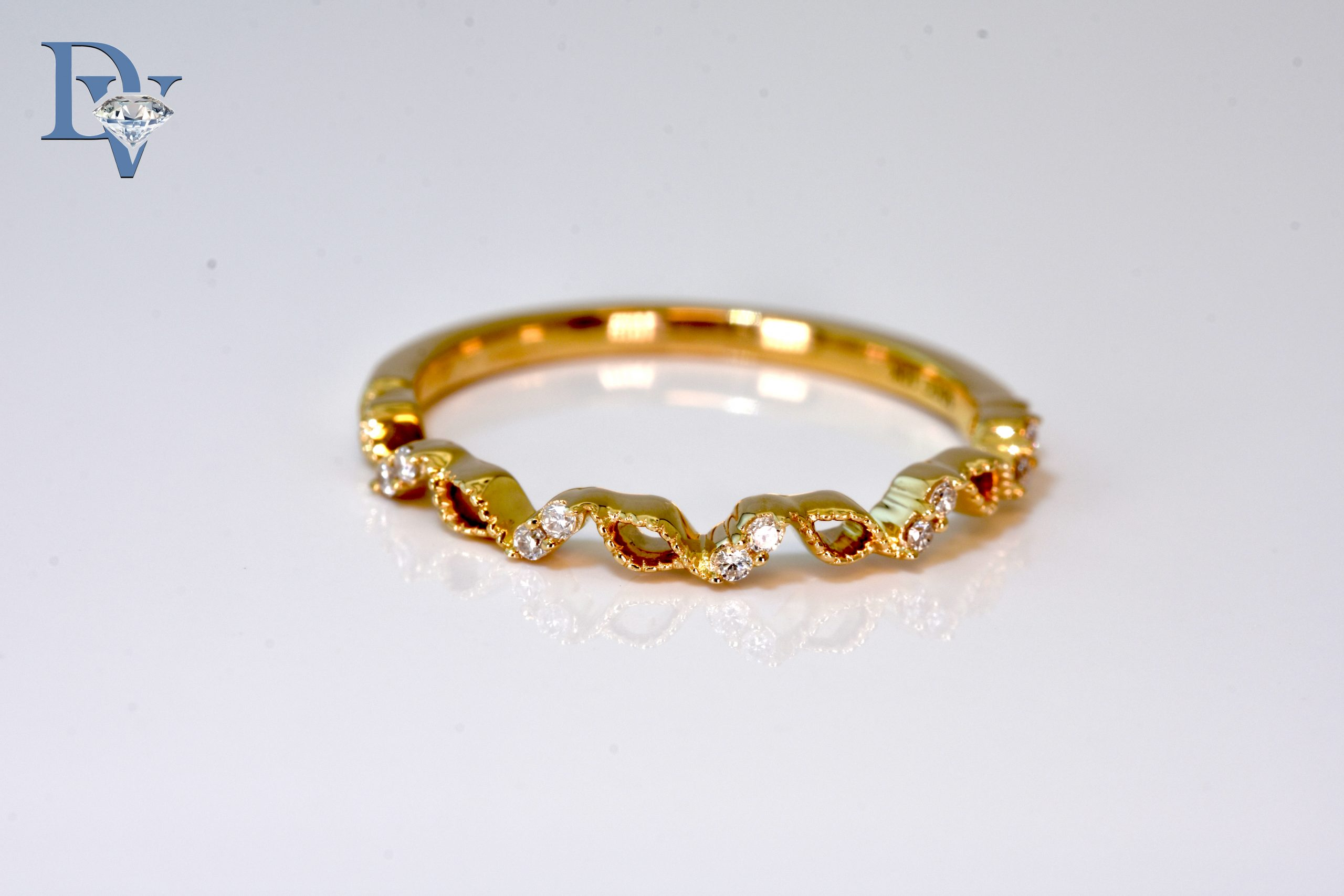 Lady's 14 kt. Yellow Gold and Diamond Fashion Ring.  .06 ct. tdwt.