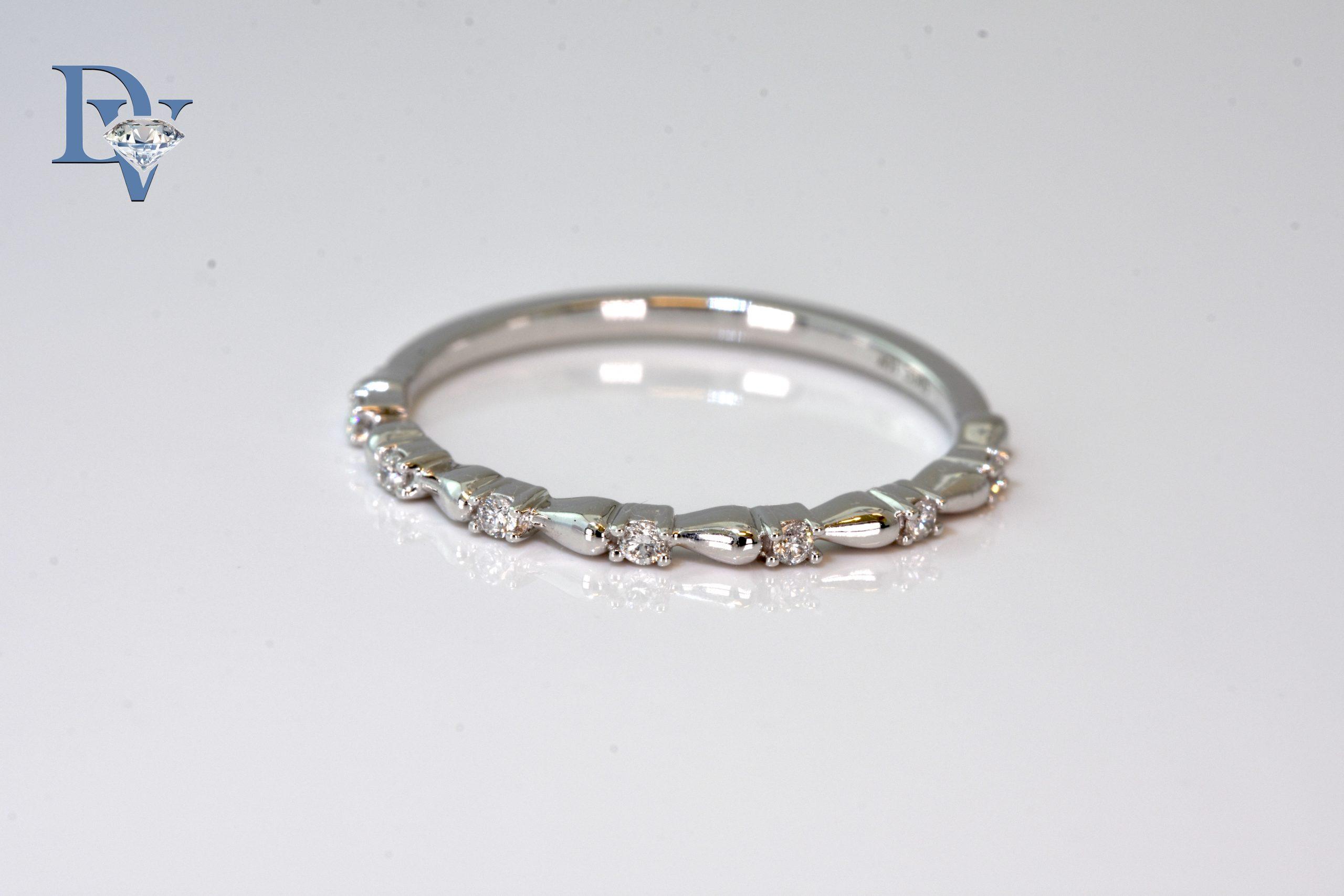 Lady's 14 kt. White Gold Diamond Fashion Ring.   .07ct tdwt.