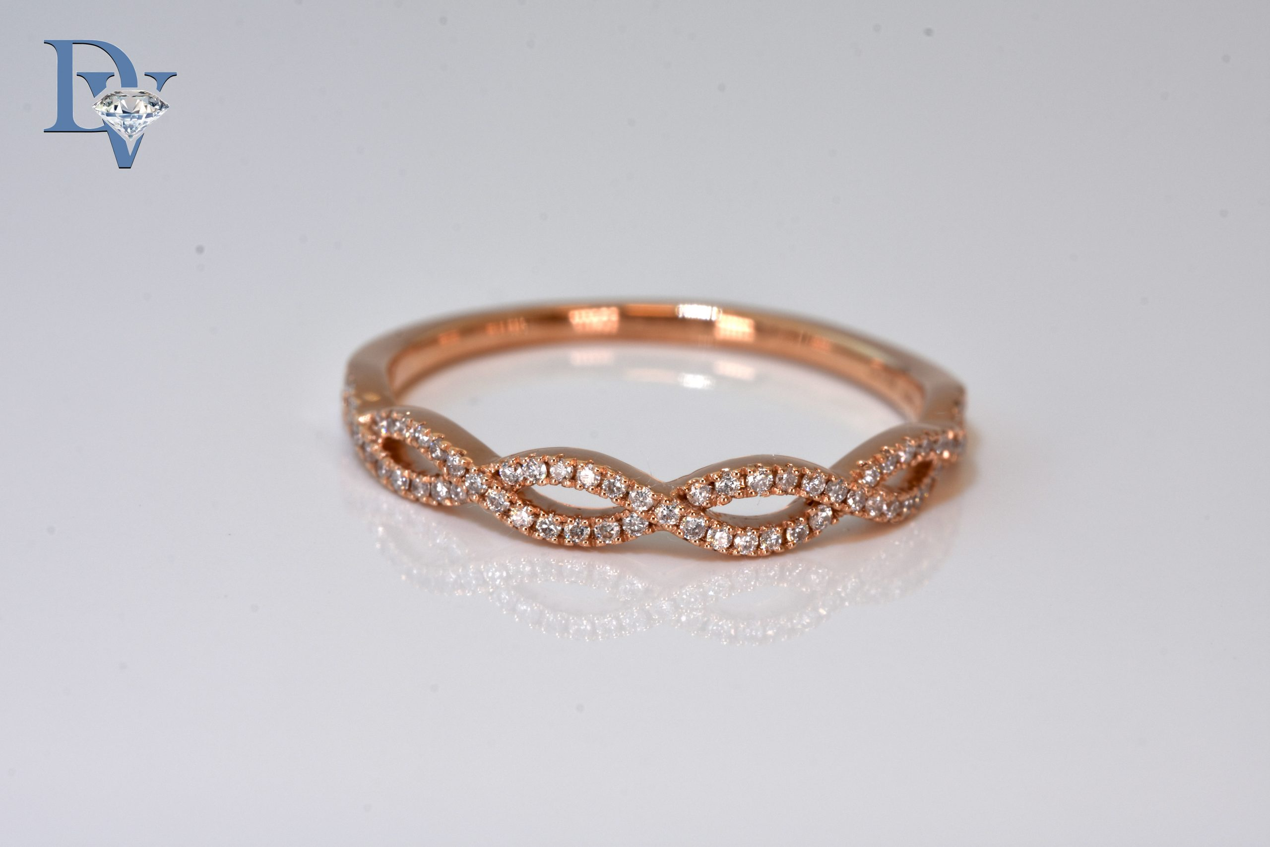 Lady's 14 kt. Rose Gold and Diamond Fashion Ring.  .14 ct. tdwt.