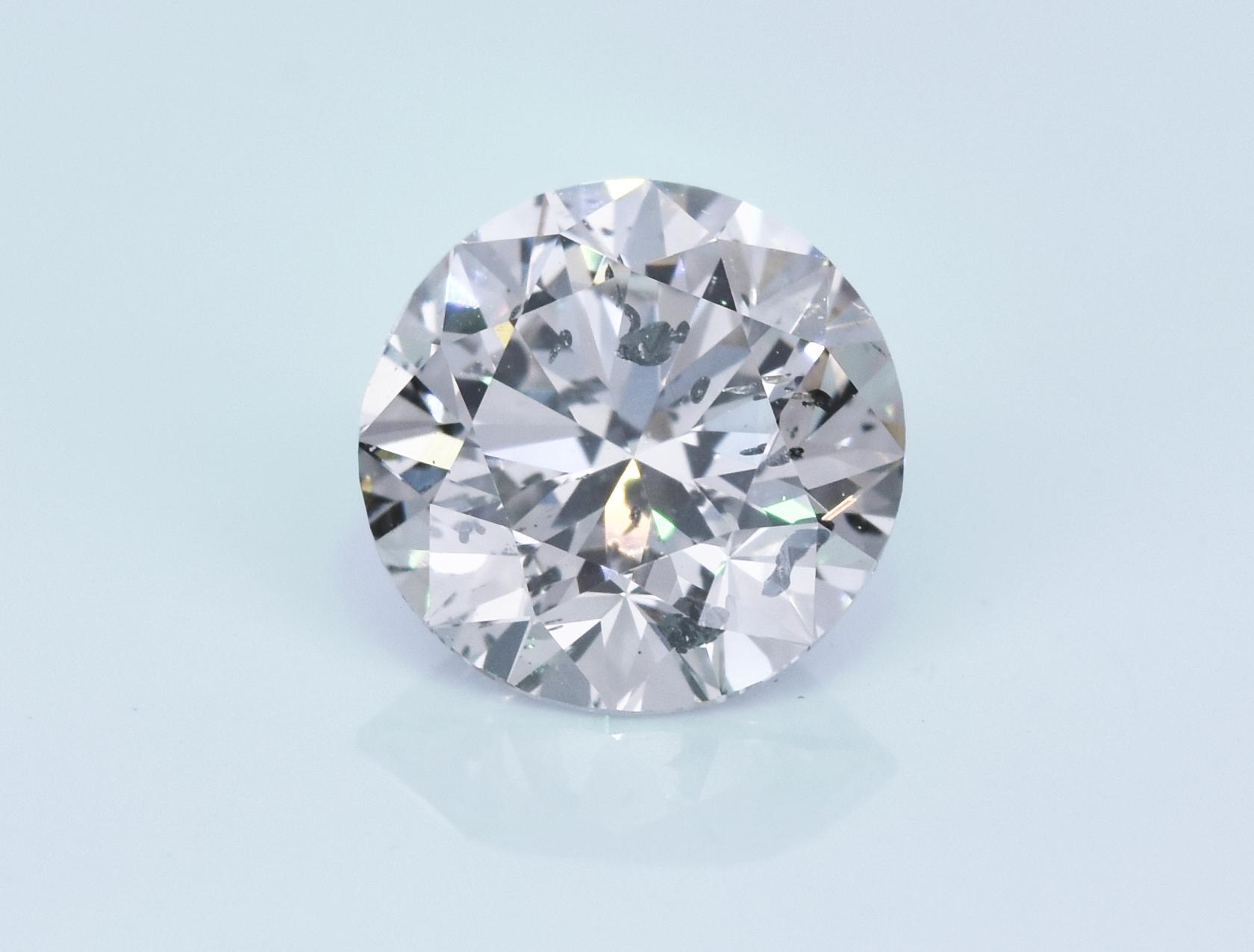 1.52 carat loose round diamond. I1, L