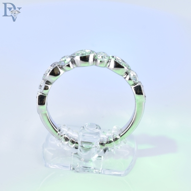 Designer-Diamonds Forever-14 kt. White Gold Diamond Wedding Band.  9 Round Brilliant Cut Diamonds totaling .50 carats diamond weight.  SI1 Clarity, GH Color.  Sku#110-01126